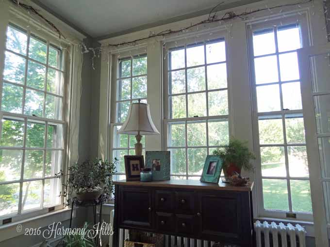 Welcome to our Sunroom! Come take a tour of our 1925 sunroom with all eleven of the original wood 9-over-9 windows still in place. Gorgeous, bright room! Click now or re-pin for later! www.HarmonyHillsHomeandGarden.com