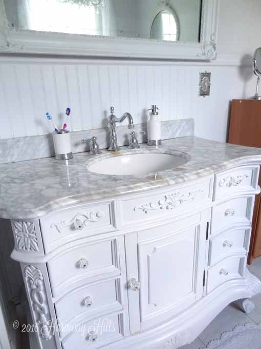 Trend Soft u Serene Bathroom Grey and white bathroom with marble vanity antique mirrors