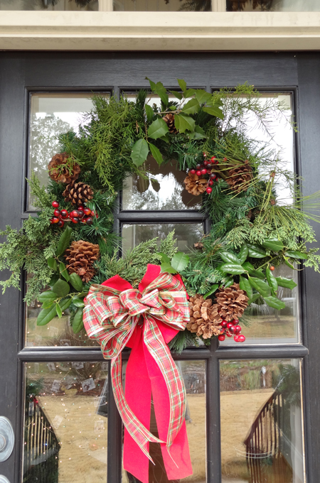 Add fresh greens and berries to a faux wreath